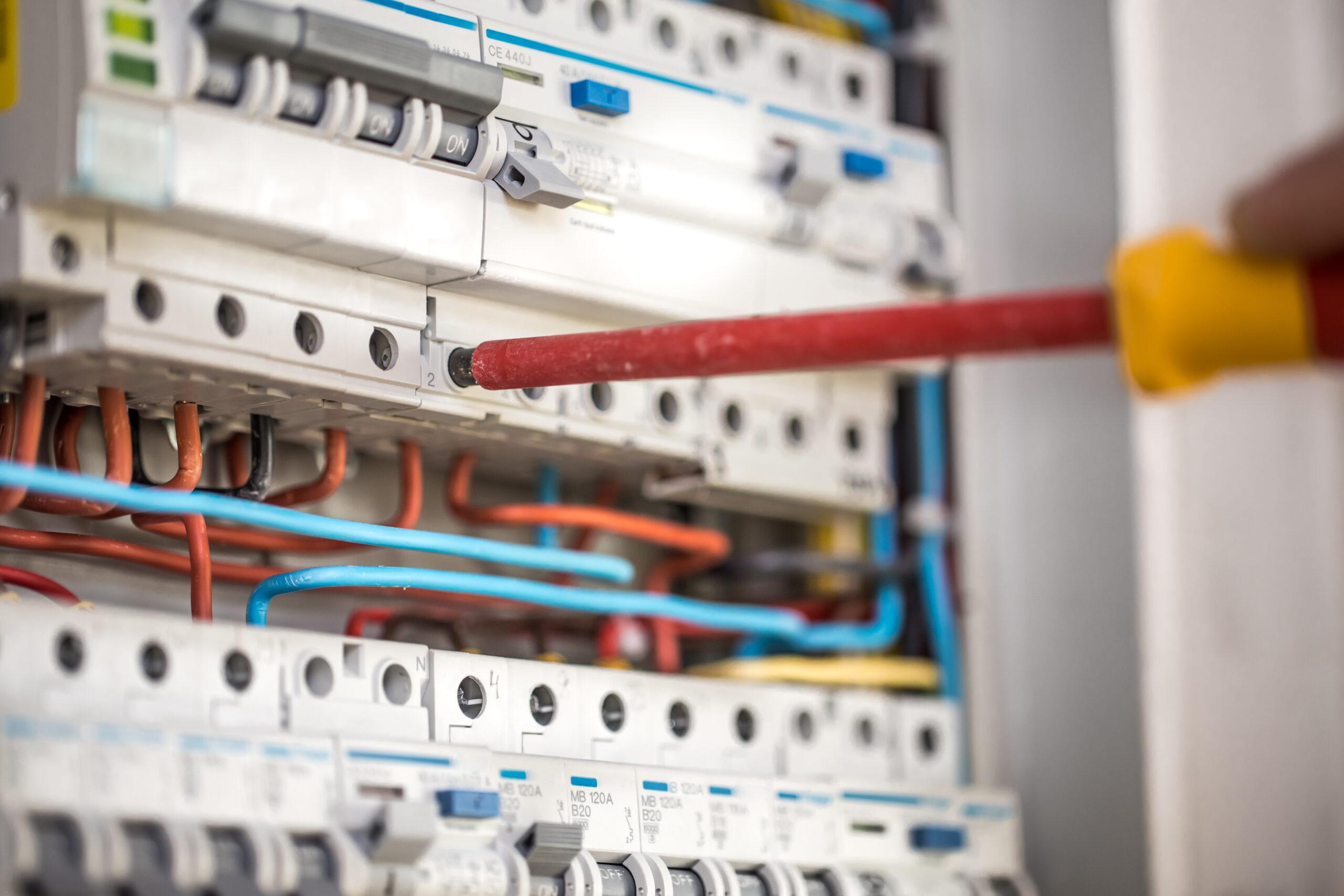 man-an-electrical-technician-working-in-a-switchbo-GW5HTSZ